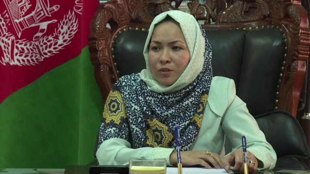 surrounded by male advisors and condescending mansplainers afghanistans only female governor masooma muradi holds her own against a deep underswell... - politician stock videos & royalty-free footage