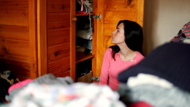 surrounded by messy wardrobe - top capo di vestiario video stock e b–roll