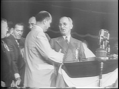 surrounded by people at the democratic national convention, harry s truman sits eating a sandwich before giving his acceptance speech to be the... - harry truman stock videos & royalty-free footage
