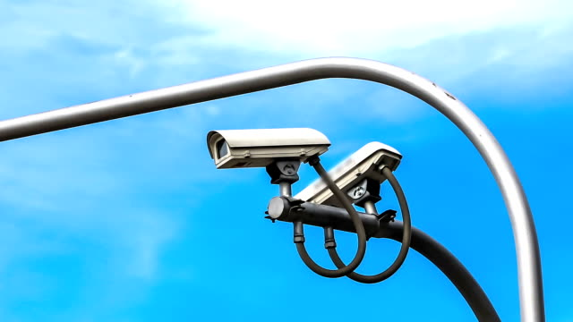 surveillance camera against blue sky - pole stock videos and b-roll footage