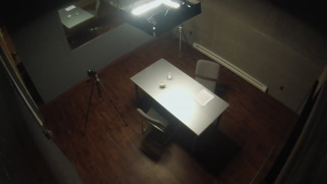 surveillance camera pov of interrogation room with cameras - legal trial stock videos & royalty-free footage