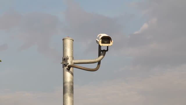 surveillance camera with blue sky. - pole stock videos & royalty-free footage