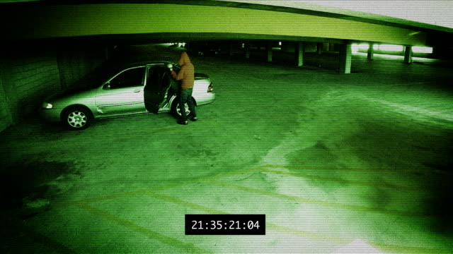 stockvideo's en b-roll-footage met surveillance - parking garage theft - steel