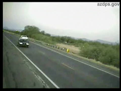 vídeos de stock e filmes b-roll de / surveillance video of bus driving along and suddenly veering off road / crumpled car and no movement from anyone in car, people slowly stumble and... - amarrotado