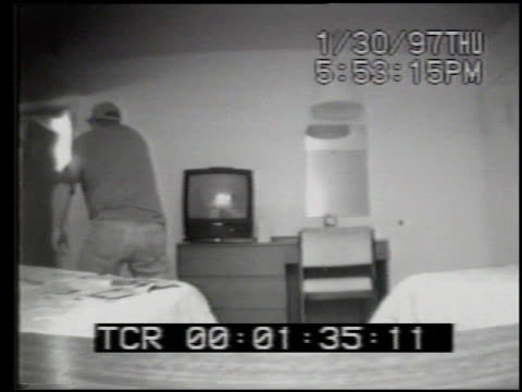 december 03, 1997: fbi surveillance video of joe riley, , entering a kansas city, mo motel 6 guest room to buy cocaine from fbi informant joe... - crime or recreational drug or prison or legal trial video stock e b–roll