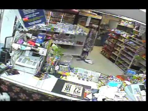 / surveillance video of thief walking into convenience store / man wearing hoodie and sunglasses pulls out small knife and asks clerk for all the... - thief stock videos & royalty-free footage