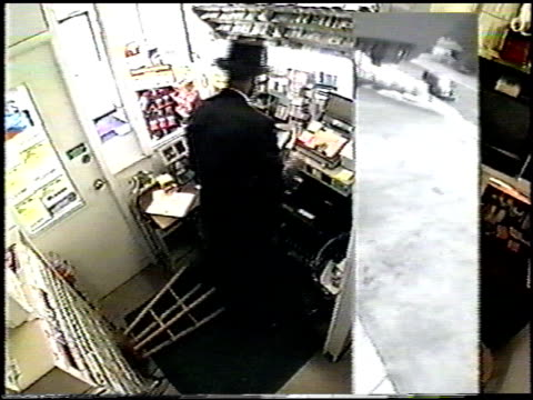 stockvideo's en b-roll-footage met / surveillance video of woman working in toll booth and man dressed as abe lincoln bursts into booth and demands money / customers approach counter... - hogehoed