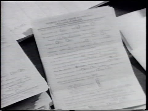 survey papers from class of 1949, female stacking opened papers into piles. automated office machine printed paper w/ letters numbers moving upward,... - moving office stock videos & royalty-free footage