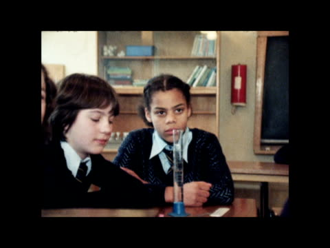 survey shows west indian girls do best and english pupils lag behind; england: leeds: bv class an indian boy another an indian girl pull back english... - leeds stock videos & royalty-free footage