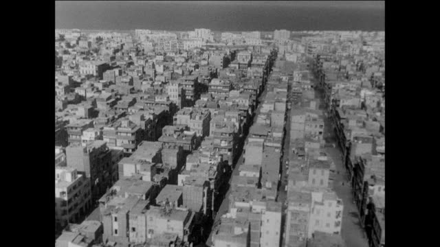 surveying the minimal damage done to port said after the conflict / egypt / suez canal crisis cease fire - port said stock videos and b-roll footage