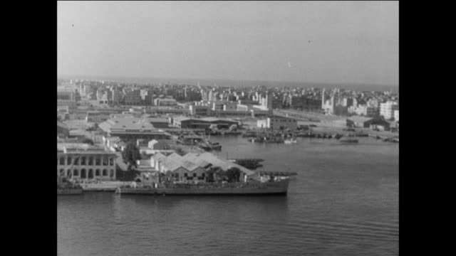 surveying the minimal damage done to port said including the water works / egypt / suez canal crisis cease fire - port said stock videos & royalty-free footage