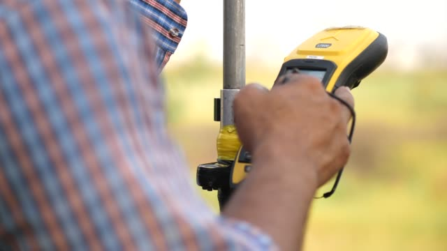 surveyor engineer is measuring level on site - land stock videos & royalty-free footage