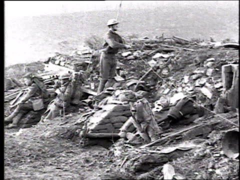 bw surveyor working two soldiers carrying wounded man on stretcher and medics scrambling from trench to surround casualty / france - wounded stock videos & royalty-free footage