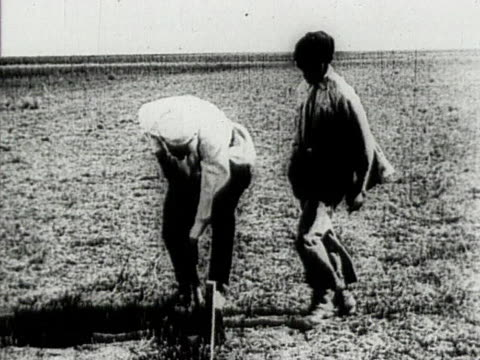 surveyors at work measuring agricultural field in crimea, ussr - ukraine stock-videos und b-roll-filmmaterial