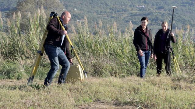Surveyors Preparing Equipment
