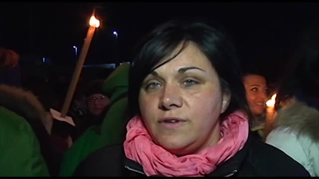 A survivor of earthquake in Amatrice during a torchlight procession for earthquake victims in L'Aquila Italy April 5 2017 on the eve of the eigth...