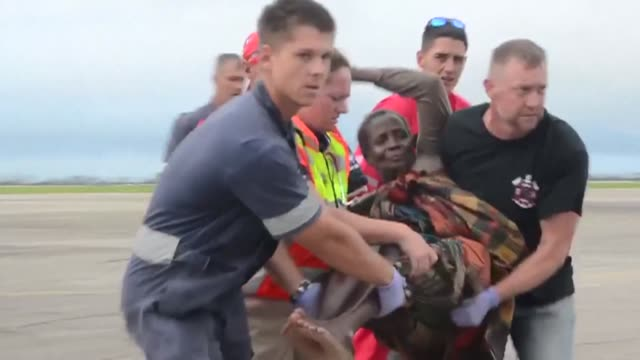 survivors are escorted to safety by aid workers at beira's airport in central mozambique after a monster storm which officials fear claimed more than... - mozambique stock videos & royalty-free footage