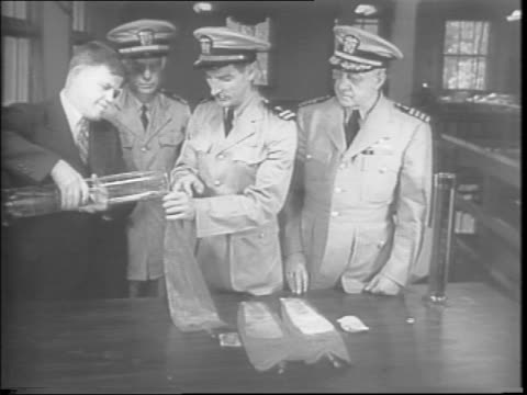 survivors found on a raft on the ocean / in a hospital bed american captain edward rickenbacker safe after 23 days on a raft / footage showing how to... - anno 1943 video stock e b–roll
