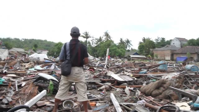 survivors from remote villages search for belongings amid extensive debris after indonesia's volcano-triggered tsunami - indonesia stock videos & royalty-free footage