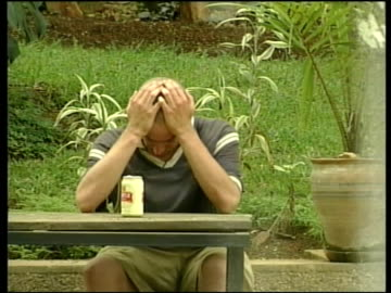 survivors massacre: survivors return home; ugandan massacre: survivors massacre: survivors return home; itn uganda: kampala: ext gv survivior of... - 性感染症点の映像素材/bロール