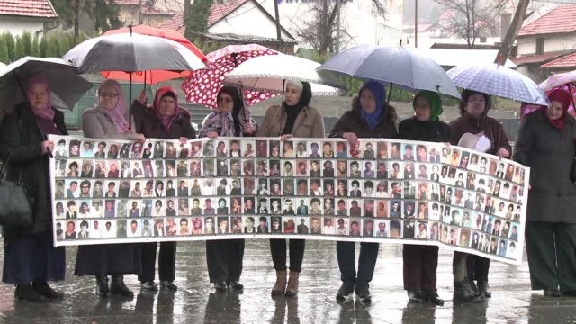 survivors of bosnia's srebrenica massacre gather for a monthly demonstration in tuzla saying they hope a un court will sentence convicted war... - radovan karadzic stock videos & royalty-free footage
