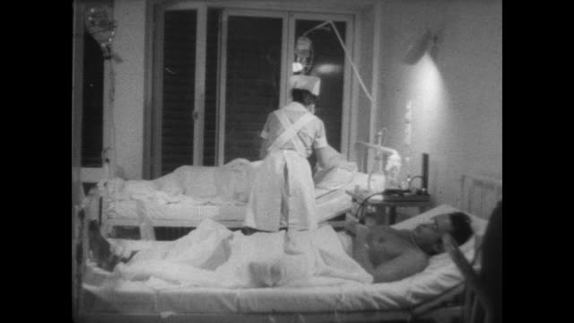 survivors of destroyer elath in hospital tended by staff / individual survivors in their hospital beds / woman kisses patient / huge crowd following... - haifa stock videos and b-roll footage
