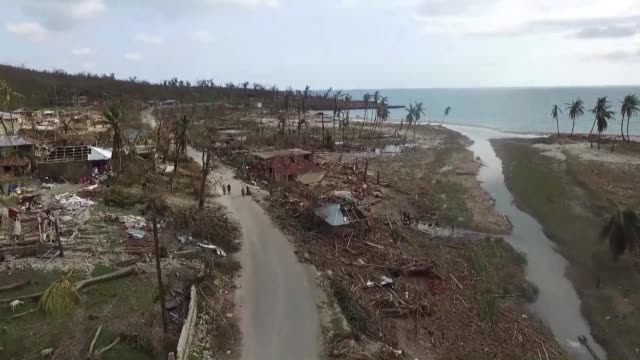 survivors of hurricane matthew in southern haiti have massed in shelters or in crumpled homes along a shredded coast - haiti stock videos & royalty-free footage
