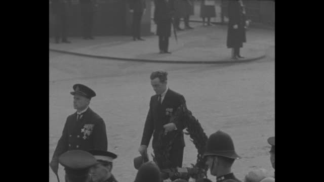 survivors of r101 airship disaster walk in the london funeral procession of those killed; one man carries a wreath over his arm / royal air force... - royal air force stock videos & royalty-free footage