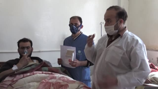 survivors of the assad regime's suspected chemical attack in khan shaykun town of idlib district receive treatment at an hospital in idlib syria on... - バッシャール・アル=アサド点の映像素材/bロール
