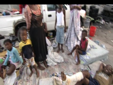 survivors wait for help and medical care at makeshift camp following devastating earthquake haiti; 19 january 2010 - victim stock videos & royalty-free footage
