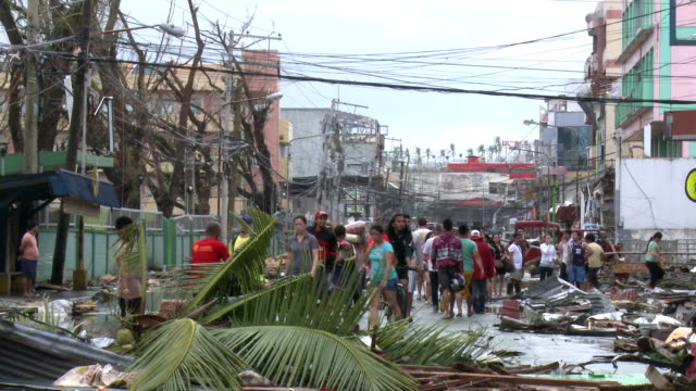 Survivors Walk Devastated Streets Of Tacloban City After Typhoon Haiyan