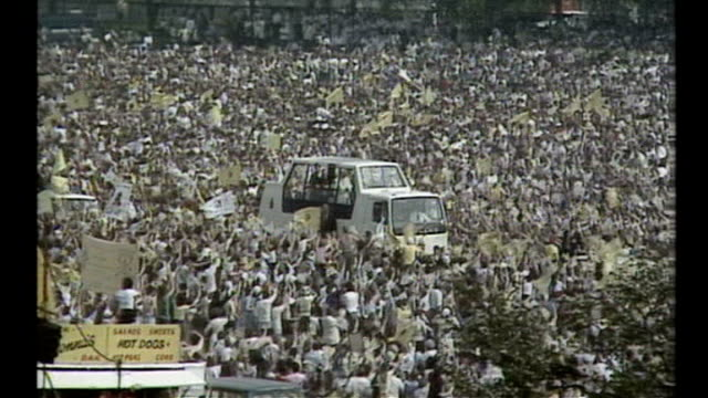 susan boyle to sing to the pope during his uk visit; tx 1982 england: ext pope john paul ii meeting people during uk visit popemobile along through... - pope john paul ii stock videos & royalty-free footage