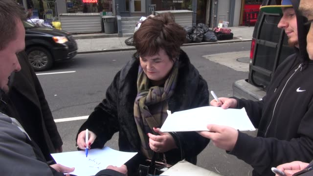 susan boylearrives at the good day new york show and signs for fans in new york city - celebrity sightings in new york city, ny on 12/03/13 - スーザン ボイル点の映像素材/bロール