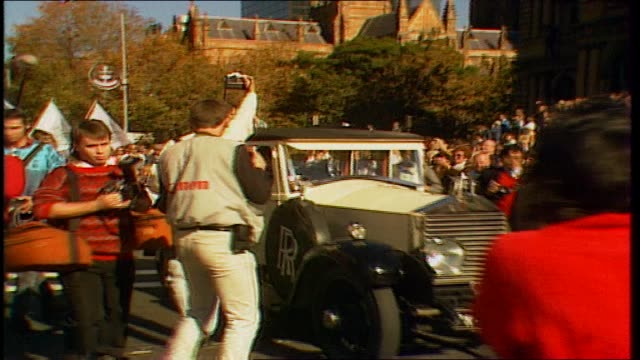 parade past sydney town hall / kay cottee in open rolls royce with her mum and dad / crowds press / various shots of parade on george street /... - rolls royce stock videos & royalty-free footage