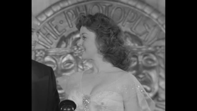 cu susan hayward holds award and looks at photoplay editorinchief fred sammis for a long time then she looks down at plaque and says îthank you mr... - plakette stock-videos und b-roll-filmmaterial