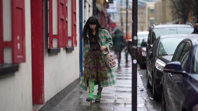 susanna lau wears a green and white checked oversized long coat a floral print pleated multicolor dress during london fashion week fall winter 2020... - floral pattern stock videos & royalty-free footage