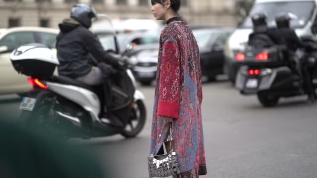 Susanna Lau wears a yellow and orange Chloe bag a red and blue geometric pattern print kimono jacket a long necklace burgundy leather shoes...