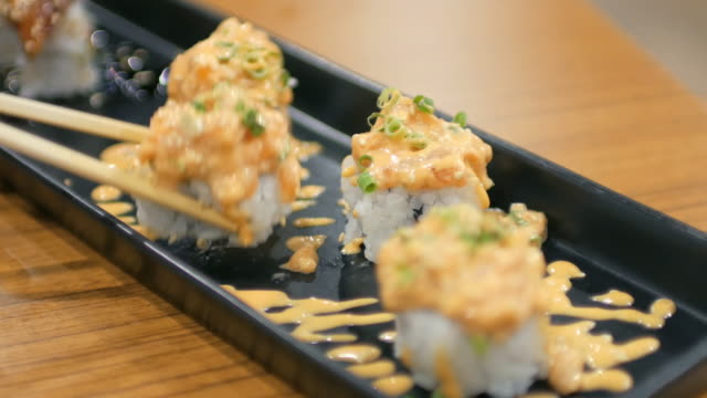 sushi bar japanese food at japanese restaurant , 4k(uhd) - dipping stock videos & royalty-free footage