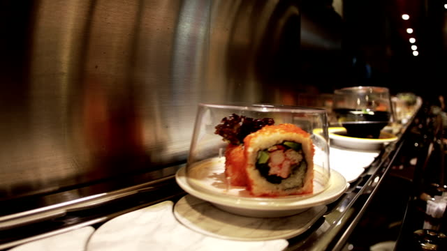 sushi bar montage in a restaurant - kitchen worktop stock videos and b-roll footage