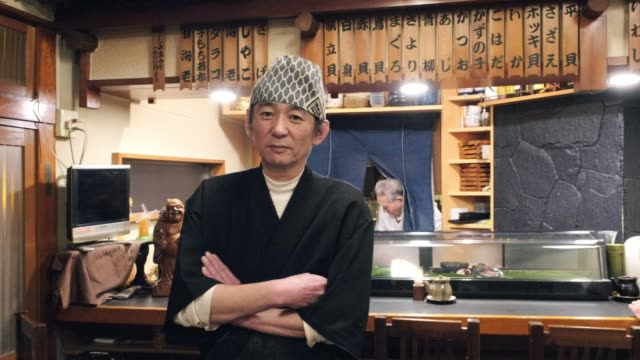 sushi chef in small tokyo restaurant - sashimi stock videos & royalty-free footage
