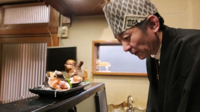 sushi chef in small tokyo restaurant - sushi stock videos & royalty-free footage