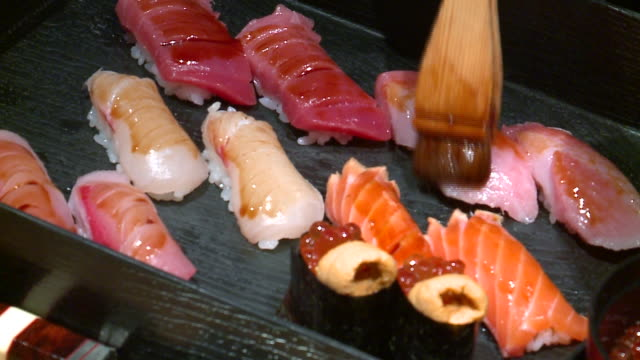 wgn sushi chef prepares nigiri pieces on march 14 2018 - nigiri stock videos and b-roll footage