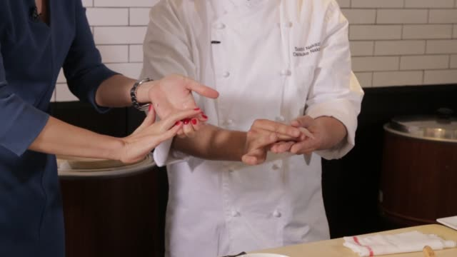 a sushi chef preparing sushi in sushi nakazawa restaurant in new york city new york on march 24th 2015 shots interior close shot of a male chef... - wasabi stock videos and b-roll footage