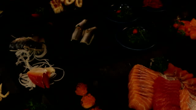 sushi in the japanese restaurant, food is cooked from the chefs, very good, very tasty. - sushi stock videos and b-roll footage