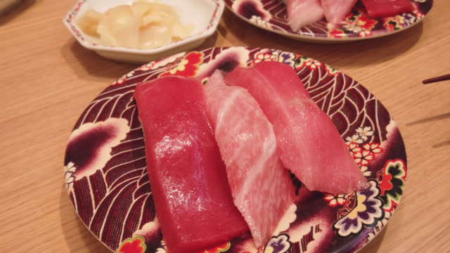 sushi - maguro tuna in restaurant, japan - toro fish stock videos and b-roll footage