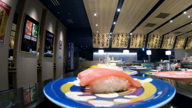 POV, CU Sushi on a conveyer belt / Tokyo, Japan