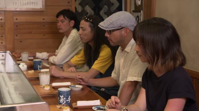sushi restaurant - nagasaki, japan - essbesteck stock-videos und b-roll-filmmaterial