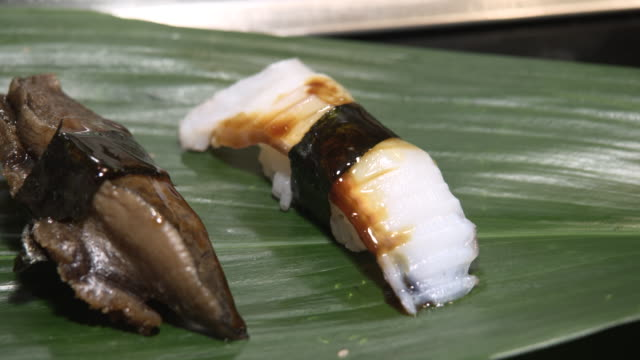 sushi restaurant - tsukiji market tokyo, japan - nigiri stock videos and b-roll footage
