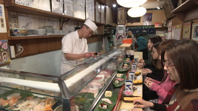sushi restaurant - tsukiji market tokyo, japan - sushi stock videos and b-roll footage