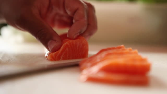 ms r/f sushiman slicing some salmon sashimis, typical brazilian night life / sao paulo, brazil - sushi video stock e b–roll